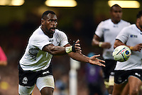 Lepani Botia of Fiji passes the ball. Rugby World Cup Pool A match between Wales and Fiji on October 1, 2015 at the Millennium Stadium in Cardiff, Wales. Photo by: Patrick Khachfe / Onside Images