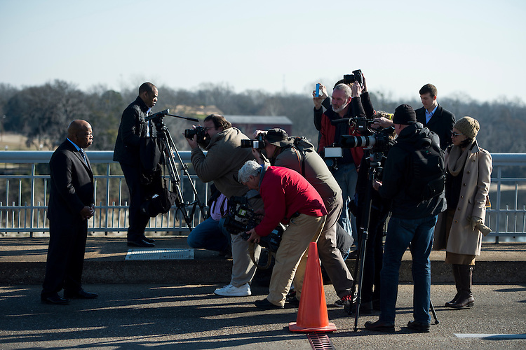 "UNITED STATES - FEBRUARY 14: News photographers take photographs of Rep. John Lewis, D-Ga., on the Edmund Pettus Bridge  on Saturday, Feb. 14, 2015. Rep. Lewis was beaten by police on the bridge on ""Bloody Sunday"" 50 years ago on March 7, 1965, during an attempted march for voting rights from Selma to Montgomery. (Photo By Bill Clark/CQ Roll Call)"