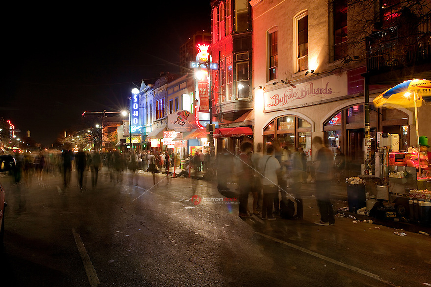 Visitors and locals walk down famous 6th street during SXSW Music Festival
