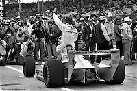 INDIANAPOLIS, IN: Johnny Rutherford waves to the crowd after winning the pole position for the 1980 Indianapolis 500, run on May 25, 1980, at the Indianapolis Motor Speedway.