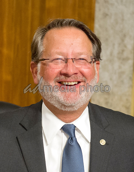 """United States Senator Gary Peters (Democrat of Michigan) smiles as he talks about his newly-grown beard prior to arrives to hearing testimony before the US Senate Committee on Armed Services on """"Recent United States Navy Incidents at Sea"""" on Capitol Hill in Washington, DC on Tuesday, September 19, 2017.  The hearing is investigating the two separate collisions with the USS Fitzgerald and USS John S. McCain that resulted in the loss of 17 US Sailors. Photo Credit: Ron Sachs/CNP/AdMedia"""