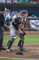 Great Falls Voyagers catcher Gunnar Troutwine (33) in front of home plate umpire Bobby Tassone during a Pioneer League against the Ogden Raptors at Lindquist Field on August 23, 2018 in Ogden, Utah. The Ogden Raptors defeated the Great Falls Voyagers by a score of 8-7. (Zachary Lucy/Four Seam Images)
