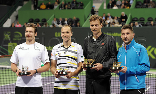 03.01.2014. Doha, Qatar.  Jan Hajek and Tomas Berdych of Czech Republic, Bruno Soares of Austria and Alexander Peya of Brazil (from R to L) pose with their trophies after the mens doules final in Qatar Open tennis tournament, Jan. 3, 2014. Tomas Berdych and Jan Hajek won 2-0.