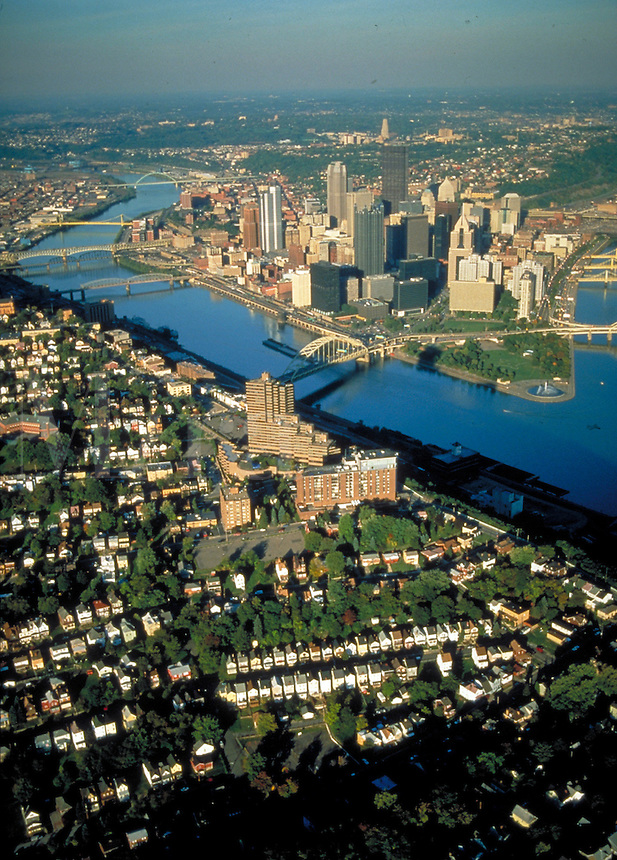 Pittsburgh's skyline shows hills and neighborhood houses as well as rivers and downtown. overview, aerial. Pittsburgh Pennsylvania United States Mt. Washington.