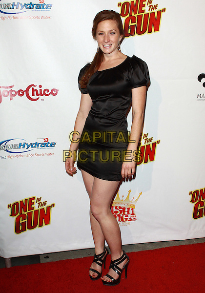 "DANA FARES.""One In The Gun"" Los Angeles Premiere  held at  Raleigh Studios, Los Angeles, California, USA..March 24th, 2010.full length black dress .CAP/ADM/TC.©T. Conrad/AdMedia/Capital Pictures."