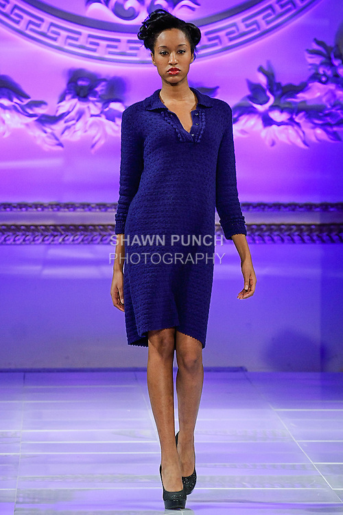 Model walks runway in an outfit from the Janerations Fall 2013 collection by Janina Stankiene, during Couture Fashion Week New York Fall 2013, February 17, 2013.
