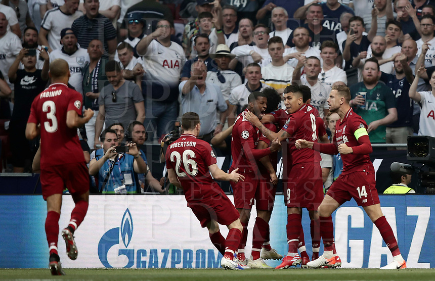 Liverpool's Mohamed Salah celebrates with his teammates after scoring on a penalty kick during the UEFA Champions League final football match between Tottenham Hotspur and Liverpool at Madrid's Wanda Metropolitano Stadium, Spain, June 1, 2019.<br /> UPDATE IMAGES PRESS/Isabella Bonotto