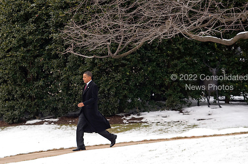United States President Barack Obama walks on the South Lawn of the White House to board Marine One in Washington, D.C., U.S., on Tuesday, February 2, 2010. Obama will travel to Nashua, New Hampshire to tour local business and hold a town hall meeting at Nashua High School North. .Credit: Andrew Harrer / Pool via CNP