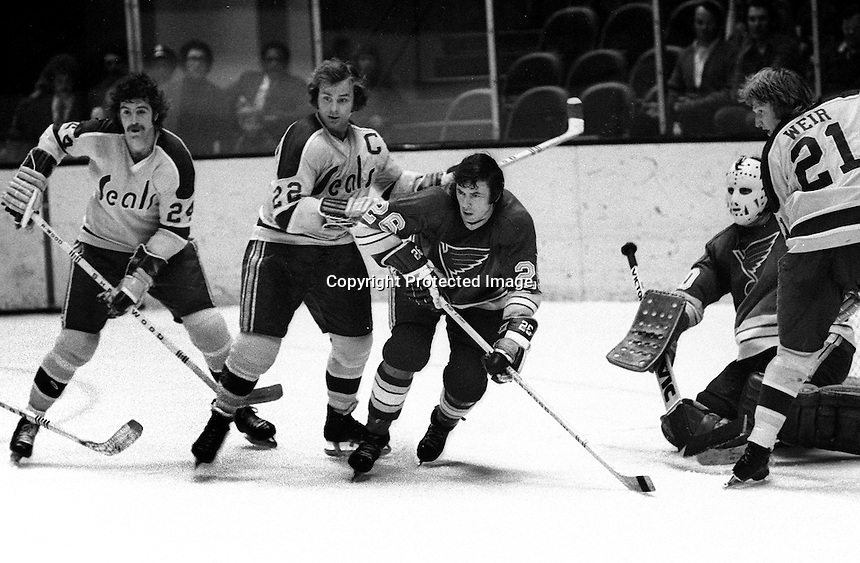 California Golden Seals Pete LaFramboise and Joey Johnston , Don Awrey of St. Louis, Stan Weir. <br />(photo/Ron Riesterer)
