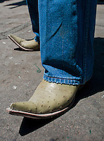 Cowboy boots. Waiting for the train in the Copper Canyon. Chihuahua, Mexico. Aromas y Sabores with Chef Patricia Quintana