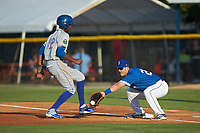 Shervyen Newton (12) of the Kingsport Mets heads back to first base as Chris Hudgins (27) of the Burlington Royals reaches for a pick-off throw at Burlington Athletic Stadium on July 27, 2018 in Burlington, North Carolina. The Mets defeated the Royals 8-0.  (Brian Westerholt/Four Seam Images)