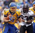 BROOKINGS, SD - OCTOBER 5:  Zach Zenner #31 from South Dakota State University looks for running room past Raysean Golden #93 from Southern Illinois in the second quarter Saturday afternoon at Coughlin Alumni Stadium in Brookings. (Photo by Dave Eggen/Inertia)