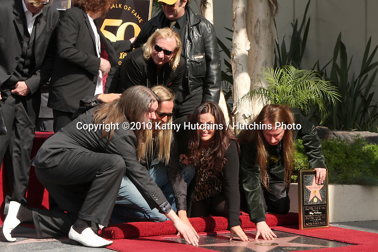 . Barbara Orbison (2nd R), wife of late singer Roy Orbison, and his sons Wesley (L), Alex (2nd L) and Roy Orbison Jr (R).Hollywood Walk of Fame Star Ceremony for Roy Orbison .Capitol Records building.Los Angeles, CA.January 29, 2010.©2010 Kathy Hutchins / Hutchins Photo....