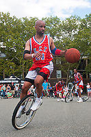 Governor's  Island, NY -  4 September 2010 King Charles Unicycle Basketball Team gives a demonstration of Unicycle Basketball at the New York City Unicycle Festival on Governor's Island.