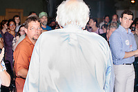 Vermont senator and Democratic presidential candidate Bernie Sanders leaves the podium after speaking at a campaign event at the White Mountain Chalet event hall in Berlin, New Hampshire.