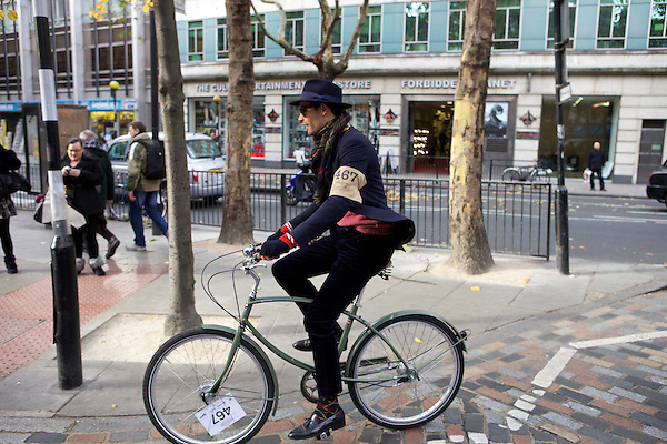 Mark-Francis Vandelli from Made in Chelsea sets off on his bicycle for The Tweed Run, London