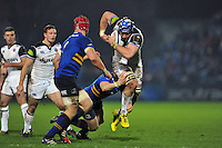 David Denton of Bath Rugby takes on the Leinster defence. European Rugby Champions Cup match, between Leinster Rugby and Bath Rugby on January 16, 2016 at the RDS Arena in Dublin, Republic of Ireland. Photo by: Patrick Khachfe / Onside Images