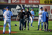 The officiating crew of Phil Bando and Edgar Morales come onto the field before the game against the Ogden Raptors and Orem Owlz at Lindquist Field on September 2, 2017 in Ogden, Utah. Ogden defeated Orem 16-4. (Stephen Smith/Four Seam Images)