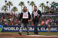SAN FRANCISCO - MARCH 18:  Photographers Andy Kuno and Jed Jacobsohn work on the field before the World Baseball Classic semi-final game between the Kingdom of the Netherlands and the Dominican Republic at AT&T Park on March 18, 2013 in San Francisco, California. (Photo by Brad Mangin)