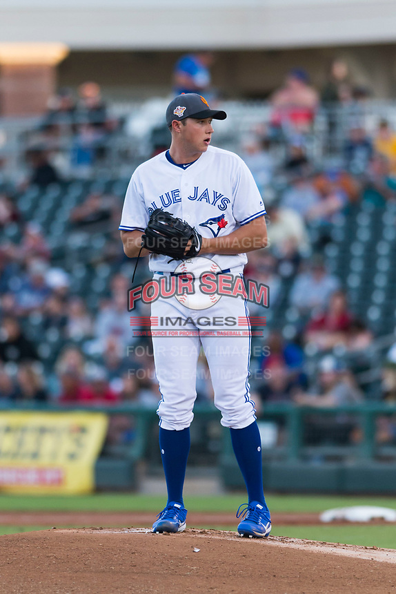 AFL West starting pitcher Nate Pearson (20), of the Surprise Saguaros and Toronto Blue Jays organization, gets ready to deliver a pitch during the Arizona Fall League Fall Stars game at Surprise Stadium on November 3, 2018 in Surprise, Arizona. The AFL West defeated the AFL East 7-6 . (Zachary Lucy/Four Seam Images)