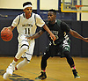 Shane Gatling #11 of Baldwin, left, ges pressured by Lloyd Bastien #20 of Campus Magnet during a non-league varsity boys' basketball game at Baldwin High School on Friday, Dec. 11, 2015. Gatling had 15 points, five assists and two steals in Baldwin's 68-49 win.