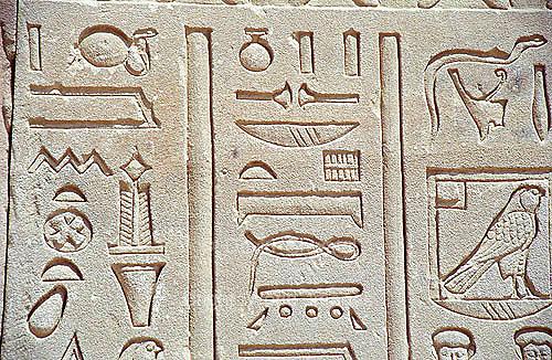 Ancient hieroglyphics adorn the walls of the temple at Dendera, Egypt
