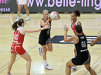 20.1.2014 New Zealand's Laura Lagman competes for ball with England's Jade Clarke during their netball test match in London, England. Mandatory Photo Credit (Pic: David Klein). ©Michael Bradley Photography.