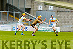 Kerry's Michael O'Leary has his eye on the sliotar despite the attention from Cillian Kiely of Offaly in the Joe McDonagh Cup relegation game in Tralee on Saturday.