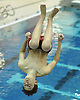 Michael Koestner of Syosset flips through the air during the Nassau County varsity boys' diving championship at Nassau Aquatic Center on Wednesday, Feb. 3, 2016.