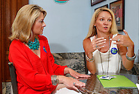 NWA Democrat-Gazette/DAVID GOTTSCHALK - 5/28/15 - Katie Tennant (left) and Sarah Sparks Diebold describe the Fayetteville Future Fund/Fayetteville Area Community Foundation Thursday May 28, 2015 in Fayetteville.