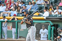 Domingo Santana (13) of the Fresno Grizzlies at bat against the Salt Lake Bees in Pacific Coast League action at Smith's Ballpark on June 13, 2015 in Salt Lake City, Utah.  (Stephen Smith/Four Seam Images)
