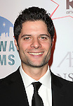 Tom Kitt attending the Broadway Dreams Foundation's 'Champagne & Caroling Gala' at Celsius at Bryant Park, New York on December 10, 2012