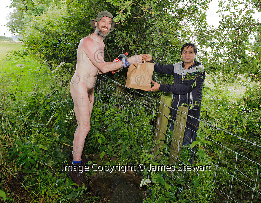 *** WARNING CONTENT MAY NOT BE SUITABLE FOR ALL ***.Naked Rambler Stephen Gough takes delivery from the local Indian takeaway at his camp in the woods near Kinross.