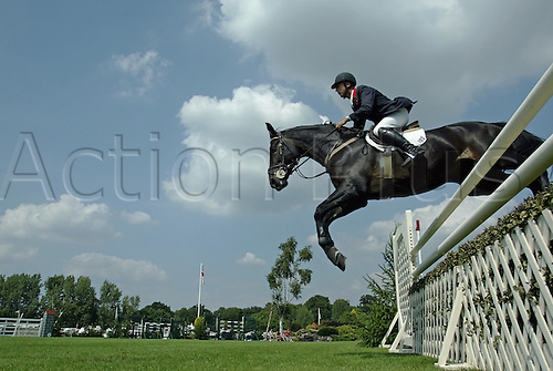 18 August 2005:  British rider Mark Armstrong rides GRAF GOLD to victory in The Hickstead Derby Salver on the first day of The British Jumping Derby Meeting, Hickstead, England. Photo: Glyn Kirk/actionplus...050818 horse rider male man men jump jumping fence