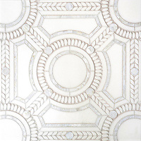 Augustus, a handmade mosaic shown in honed Thassos, tumbled Thassos and Shell. Designed by Sara Baldwin for New Ravenna.<br />