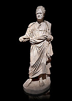 Roman statue of Emperor Priest. Marble. Perge. 2nd century AD. Inv no . Antalya Archaeology Museum; Turkey. Against a black background.