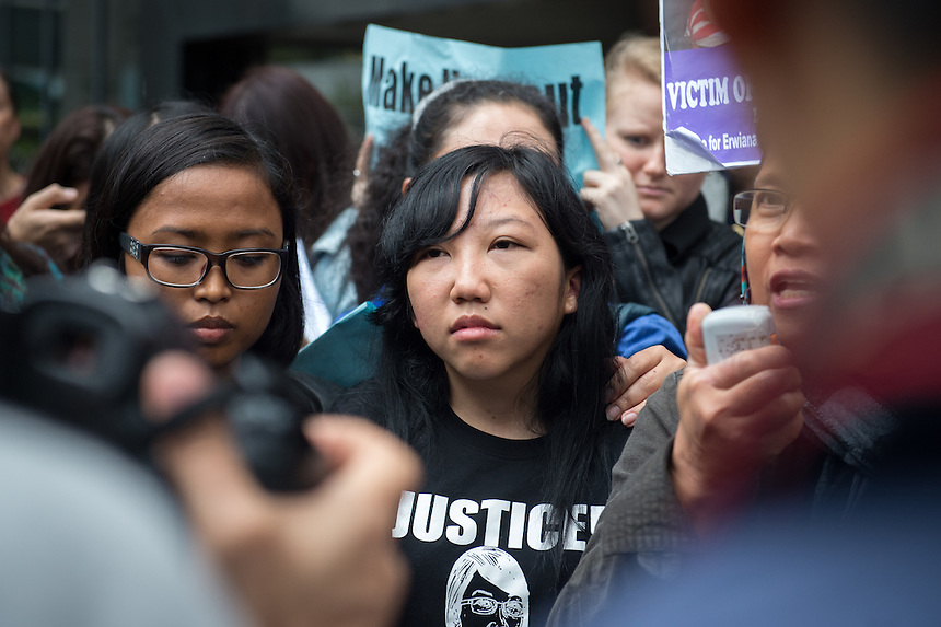 Abused Indonesian domestic helper Erwiana Sulistyaningsih talks to the media on the steps of the District Court in Wan Chai, Hong Kong. She suffered abuse at the hands of Law Wan-tung who was sentenced to six years in prison today.<br /> 27th February 2015. 27.02.15 &copy;Jayne Russell