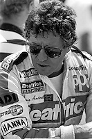 WEST ALLIS, WI - JUNE 2: Mario Andretti waits to drive the Newman Haas Racing Lola T900/Cosworth in the Miller American 200 CART IndyCar race at the Milwaukee Mile oval track in West Allis, Wisconsin, on June 2, 1985.
