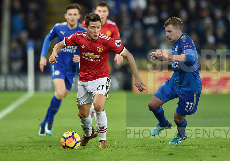 Ander Herrera of Manchester United is challenged by Marc Albrighton of Leicester City during the premier league match at the King Power Stadium, Leicester. Picture date 23rd December 2017. Picture credit should read: Robin Parker/Sportimage