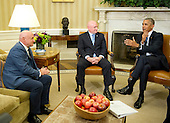 United States President Barack Obama, right, meets retired NASA astronaut Scott Kelly, center, and his brother Mark, left, in the Oval Office of the White House in Washington, DC on Friday, October 21, 2016.<br /> Credit: Ron Sachs / Pool via CNP