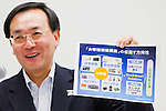 June 28, 2012, Tokyo, Japan - Panasonic Corporation's new President, Kazuhiro Tsuga, holds up a paper which explains that the company is driving towards being an environmentally friendly innovative company for customers during a news conference in downtown Tokyo. Tsuga replaced former President Fumio Ohtsubo and his goal for the company is to become the number one Geen Innovation Company by the year 2018, which is the company's 100th anniversary. (Photo by Christopher Jue/AFLO)