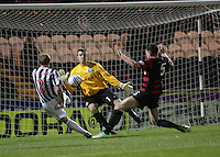 David van Zanten shoots against Ally Brown with Darren Brownlie tackling in the St Mirren v Ayr United Scottish Communities League Cup match played at St Mirren Park, Paisley on 29.8.12.