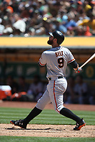 OAKLAND, CA - JULY 22:  Brandon Belt #9 of the San Francisco Giants bats against the Oakland Athletics during the game at the Oakland Coliseum on Sunday, July 22, 2018 in Oakland, California. (Photo by Brad Mangin)