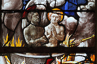 Saints Crispin and Crispinian, patron saints of cobblers, martyred at Soissons by being boiled alive in a cauldron of oil, from the Scenes of the Life and Martyrdom of Saints Crispin and Crispinian stained glass window, attributed to Nicolas le Prince, donated in 1530 by the cobblers guild in Gisors, in the Collegiate Church of Saint-Gervais-Saint-Protais, built 12th to 16th centuries in Gothic and Renaissance styles, in Gisors, Eure, Haute-Normandie, France. The church was consecrated in 1119 by Calixtus II but the nave was rebuilt from 1160 after a fire. The church was listed as a historic monument in 1840. Picture by Manuel Cohen