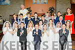 Scoil Sliabh A Mhadra NS pupils who received their First Holy Communion last Saturday in St Peter&St Paul's church Ballyduff with their teacher Mary Wallace and Fr Brendan Walsh.
