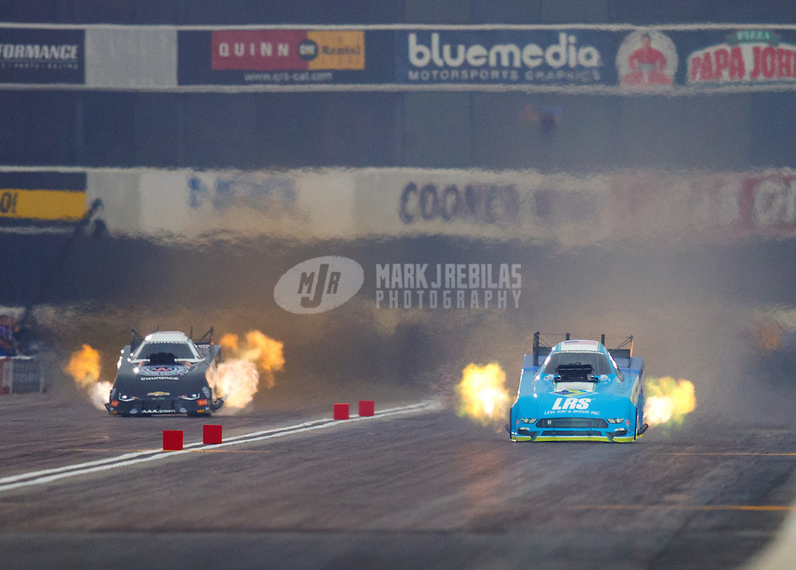 Feb 10, 2017; Pomona, CA, USA; NHRA funny car driver Tim Wilkerson (right) races alongside Robert Hight during qualifying for the Winternationals at Auto Club Raceway at Pomona. Mandatory Credit: Mark J. Rebilas-USA TODAY Sports