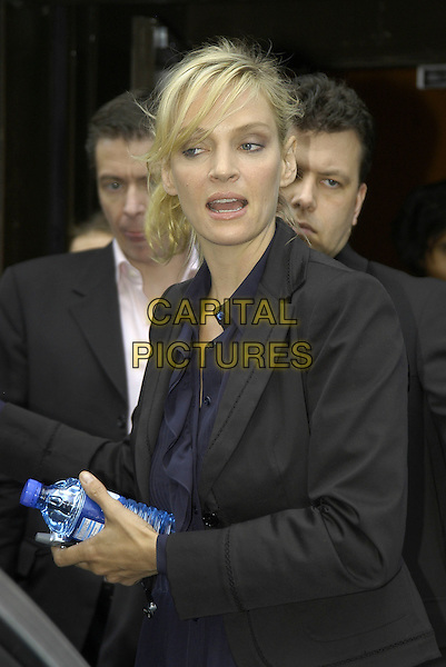 UMA THURMAN.At The Penthouse, Leicester Square, London, UK..May 10th, 2006.Ref: IA.half length black jacket mouth open bottled water.www.capitalpictures.com.sales@capitalpictures.com.©Capital Pictures