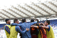 Calcio, Serie A: Lazio vs Roma. Roma, stadio Olimpico, 3 aprile 2016.<br /> Roma's Edin Dzeko is hidden by teammates hugs after scoring during the Italian Serie A football match between Lazio and Roma at Rome's Olympic stadium, 3 April 2016. Roma won 4-1.<br /> UPDATE IMAGES PRESS/Isabella Bonotto