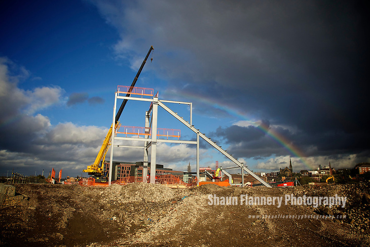 Pix: Shaun Flannery/shaunflanneryphotography.com...COPYRIGHT PICTURE&gt;&gt;SHAUN FLANNERY&gt;01302-570814&gt;&gt;07778315553&gt;&gt;..17th October 2011..................Rainbow over construction work.<br /> Eagle Platforms, Unit 22D, Orgreave Crescent, Dore Industrial Estate, S13 9NQ..Steel erectors Ellrod engineering at work with 'cherry pickers' on the site of Rotherham United's new football stadium.