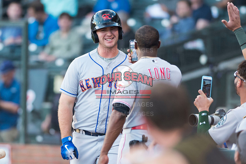 AFL East first baseman Peter Alonso (20), of the Scottsdale Scorpions and the New York Mets organization, is recorded on Instagram Live by Shed Long (6) after hitting a home run in the first inning during the Fall Stars game at Surprise Stadium on November 3, 2018 in Surprise, Arizona. The AFL West defeated the AFL East 7-6 . (Zachary Lucy/Four Seam Images)